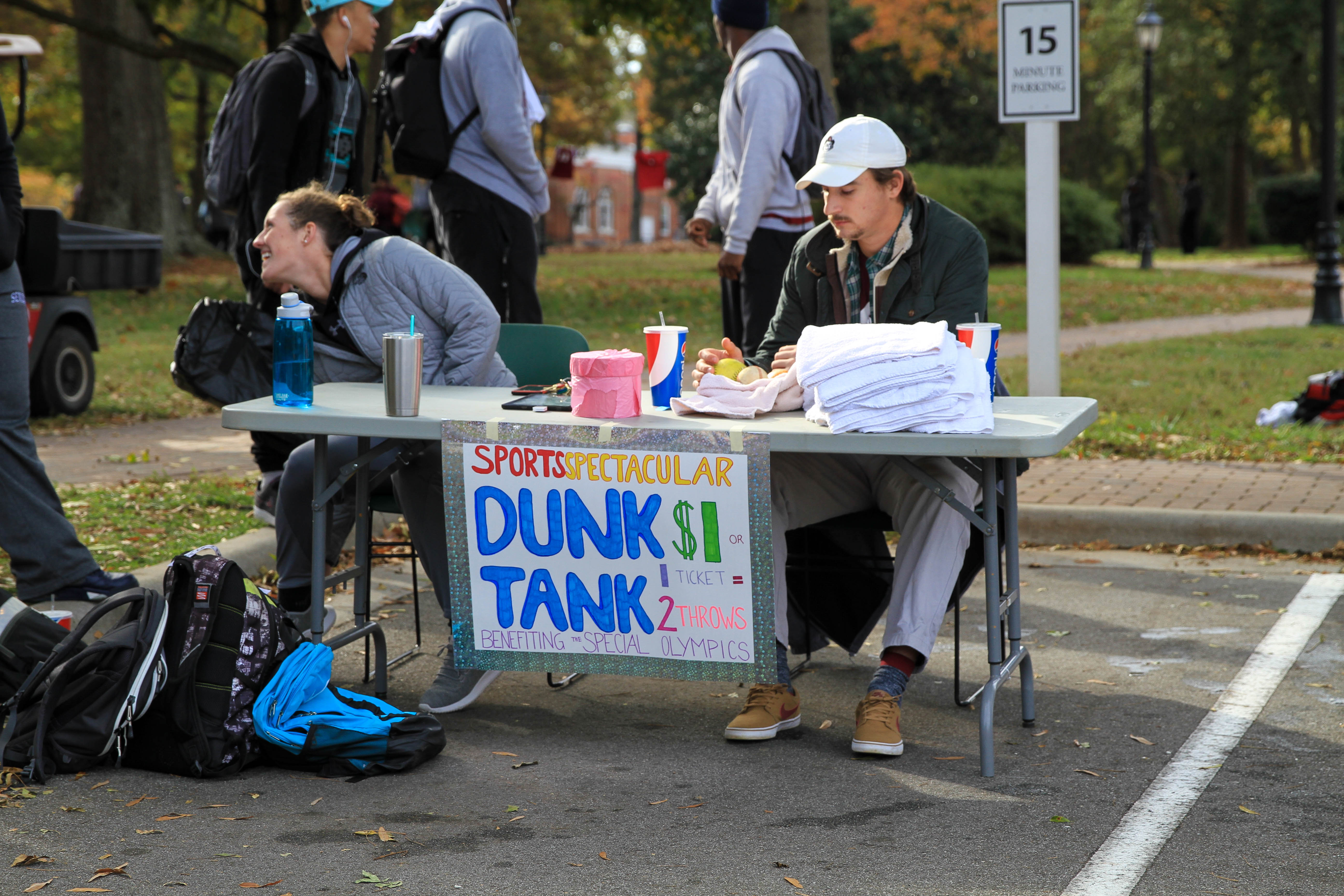 Students take donations for the dunk tank at the fall Sports Spectacular event.