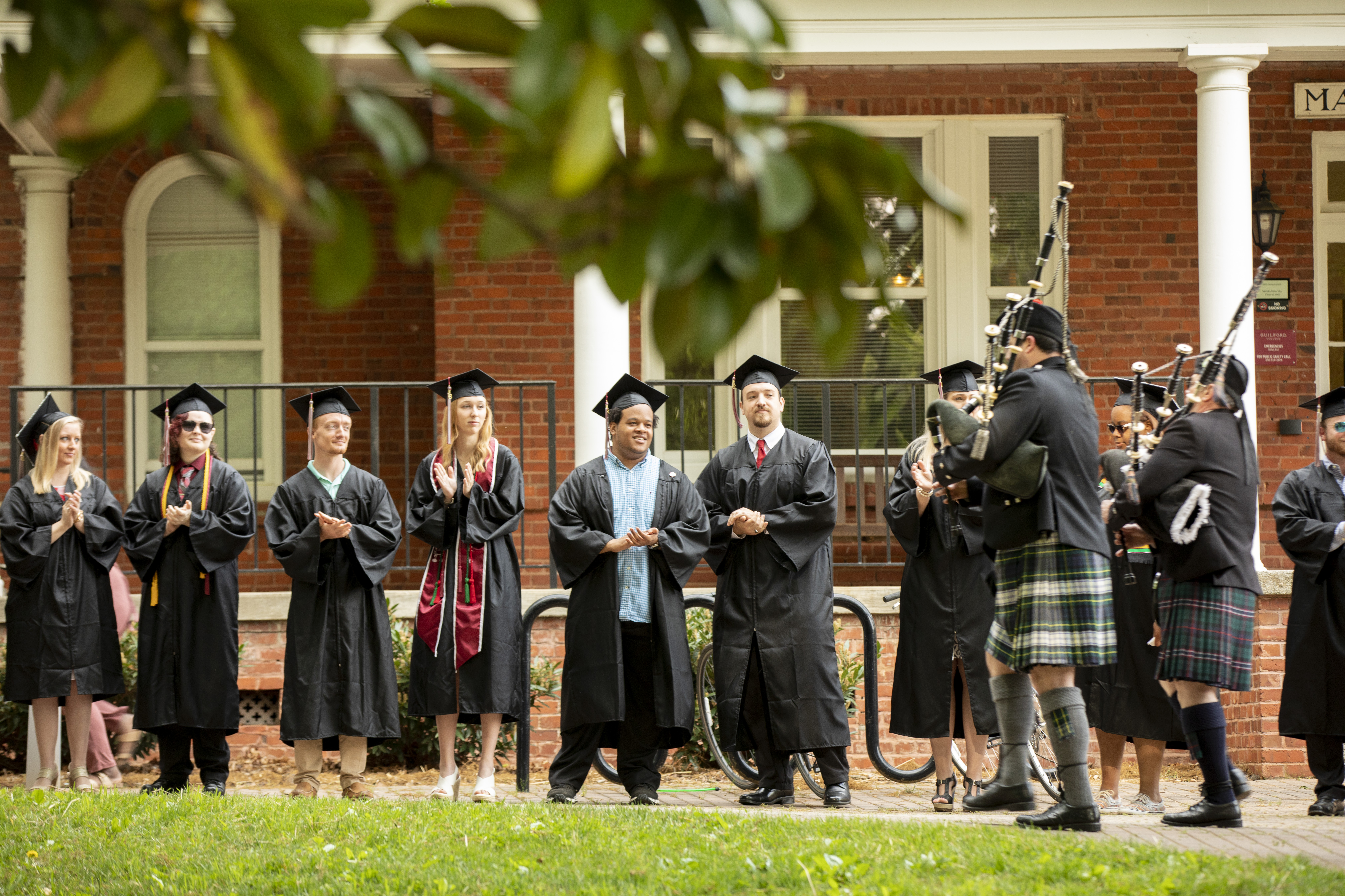 Bagpipers lead faculty to the Commencement ceremony.