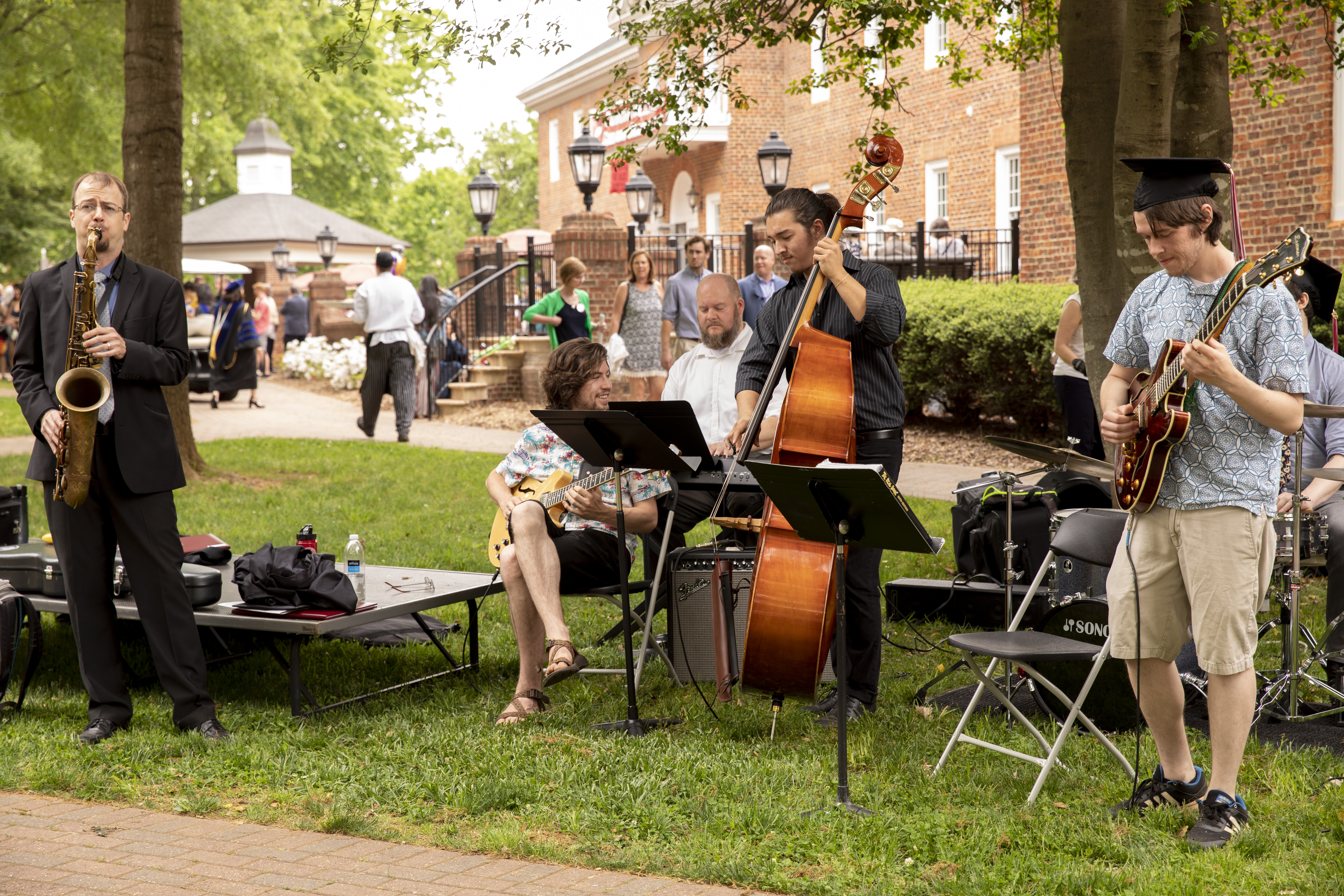 Musicians perform for visitors after Commencement.