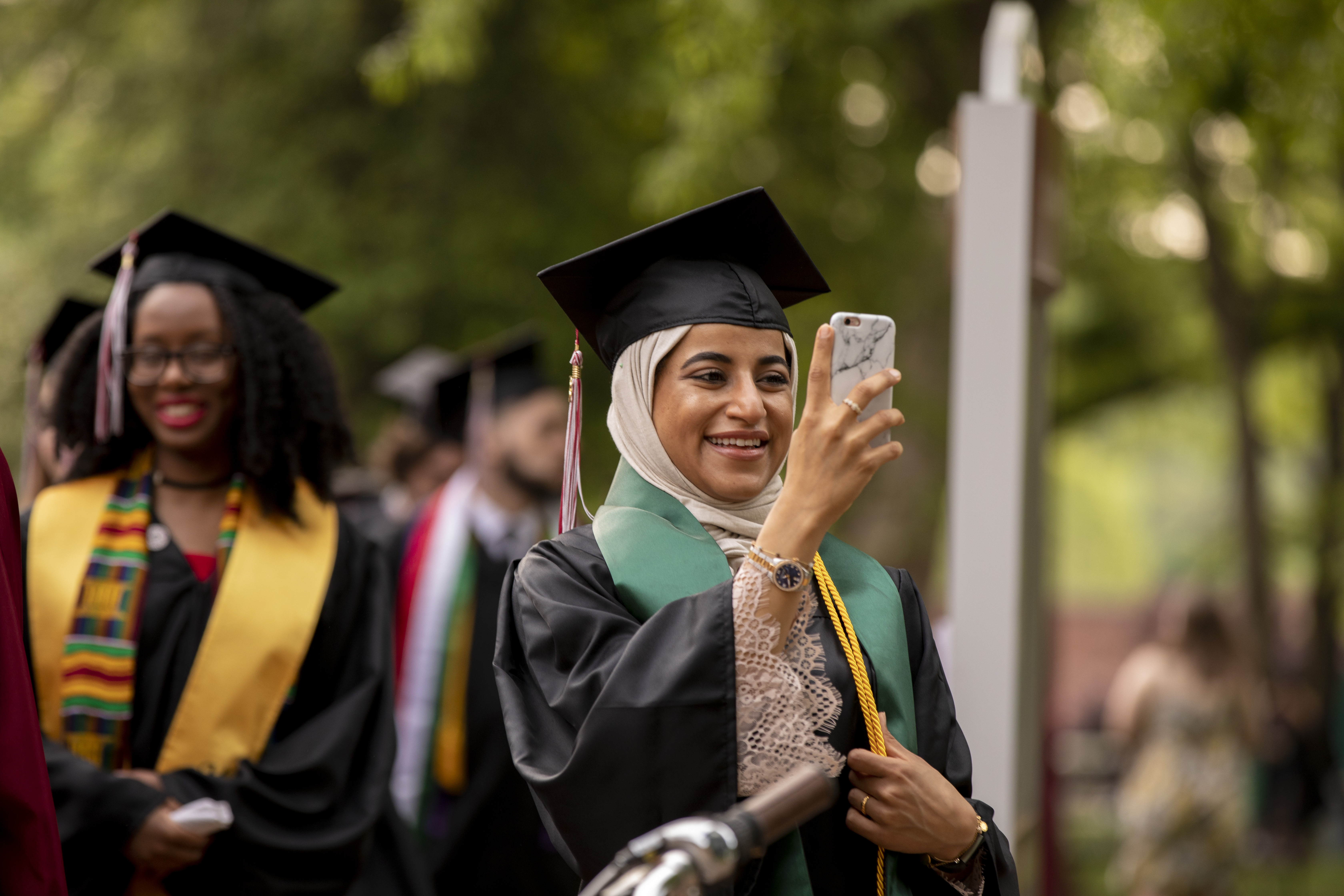 Student takes a selfie at Commencement.