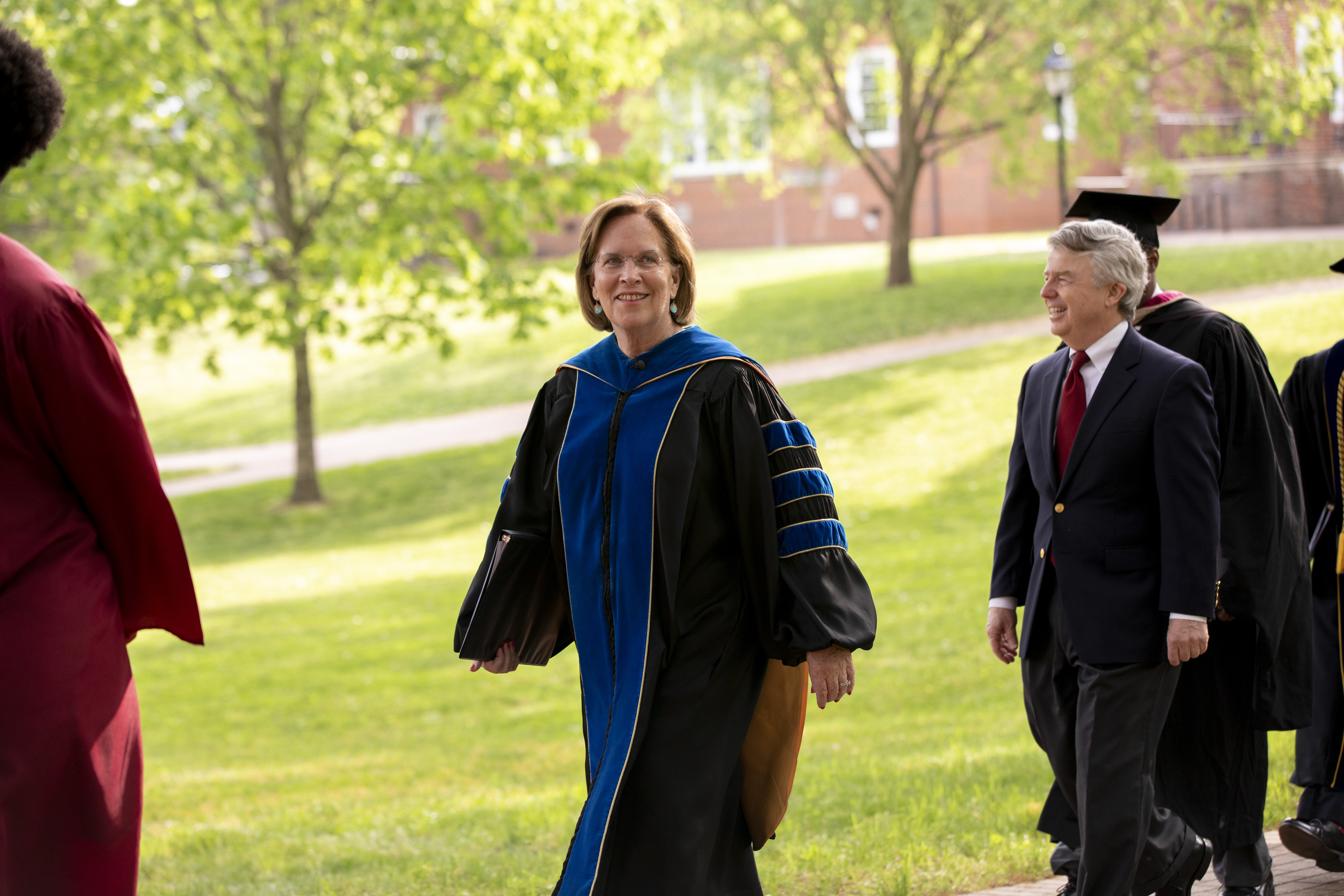 President Jane K. Fernandes leads the processional to Commencement.