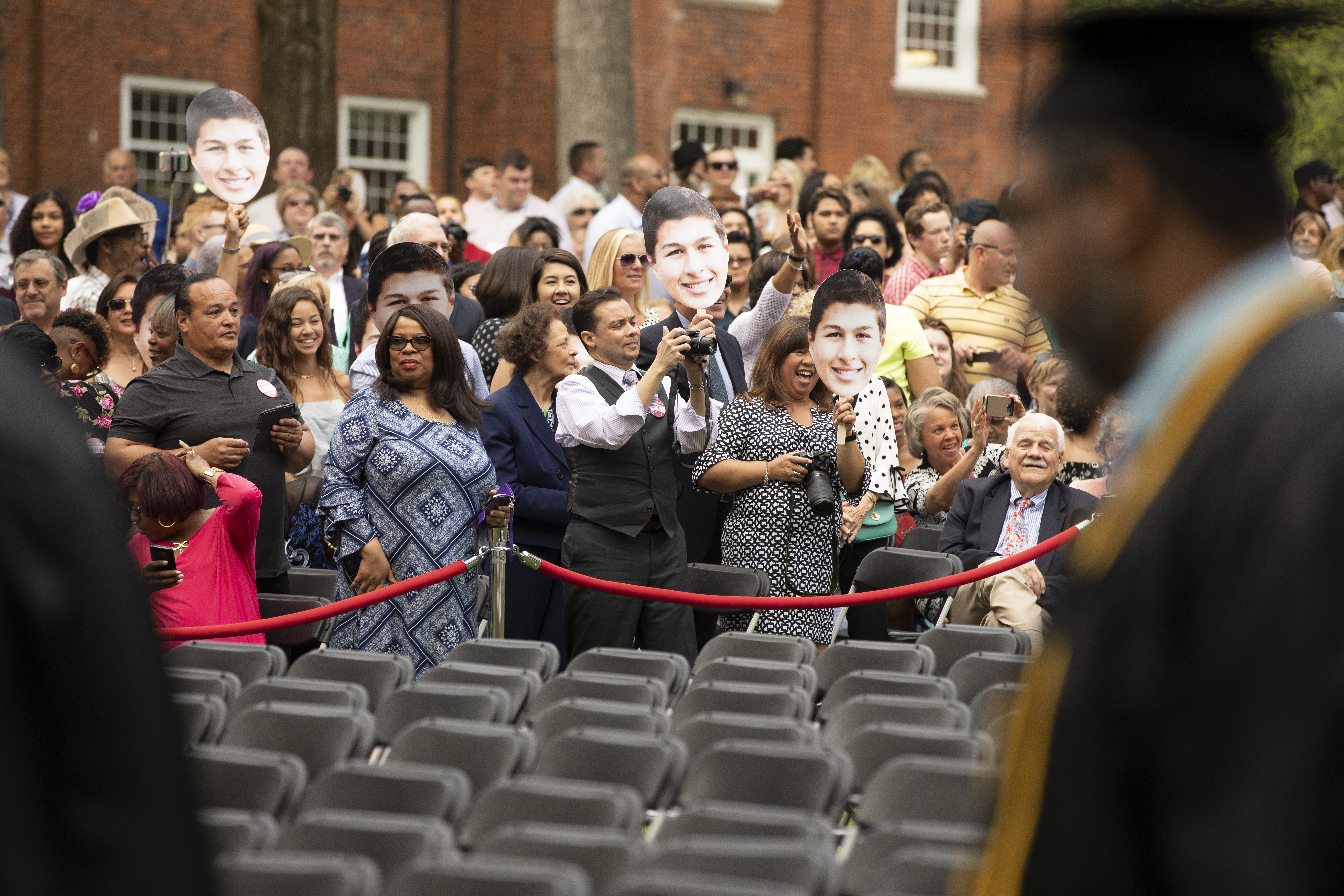 Family and friends cheer on their graduates as students are welcomed to Commencement.