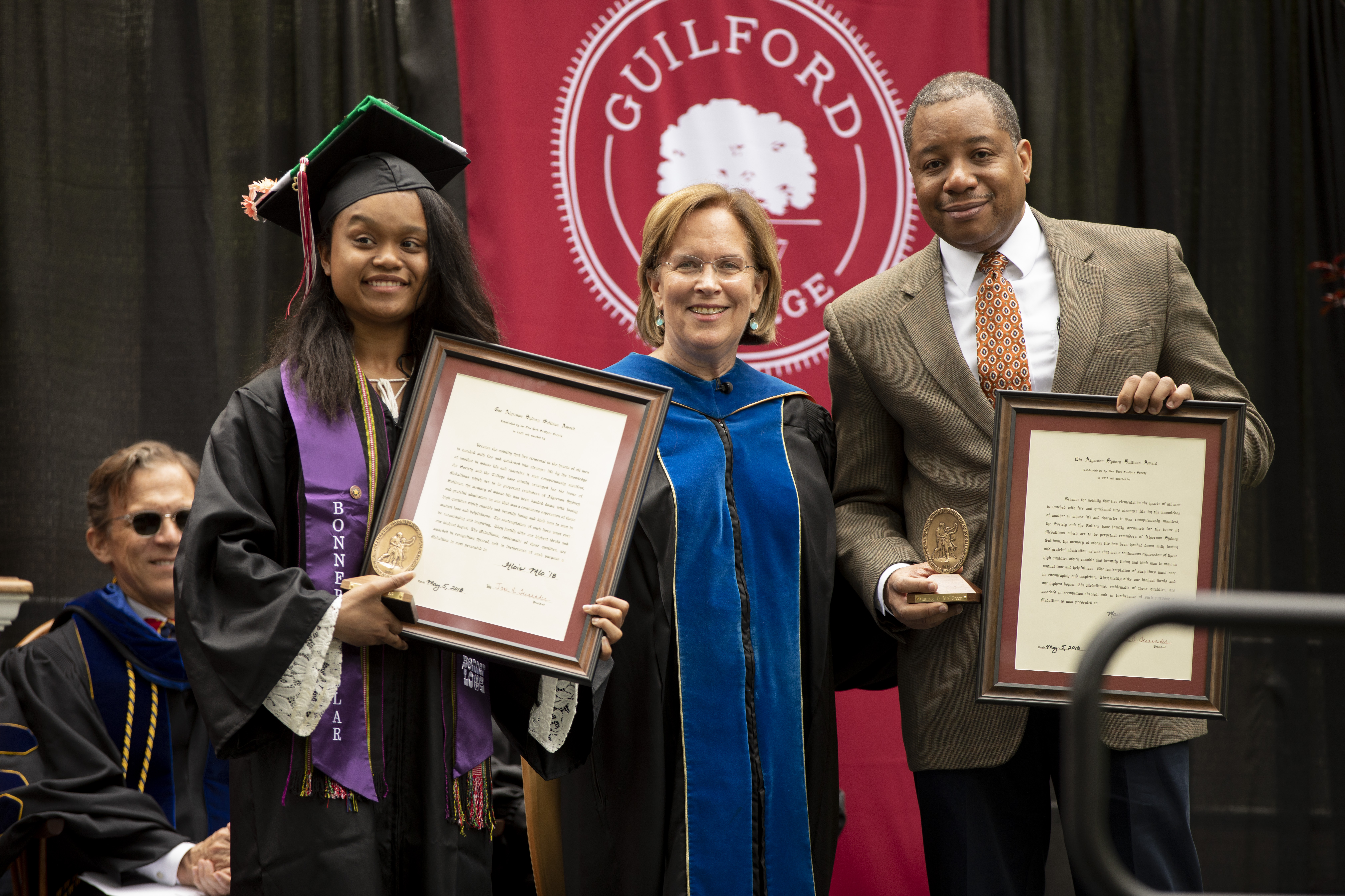 "President Jane K. Fernandes (center) with Algernon Sydney Sullivan Award recipients H'lois MLo '18 (left), B.S. Accounting, and Maurice ""Mo"" Green, Executive Director of the Z. Smith Reynolds Foundation and former Superintendent of Guilford County Schools."