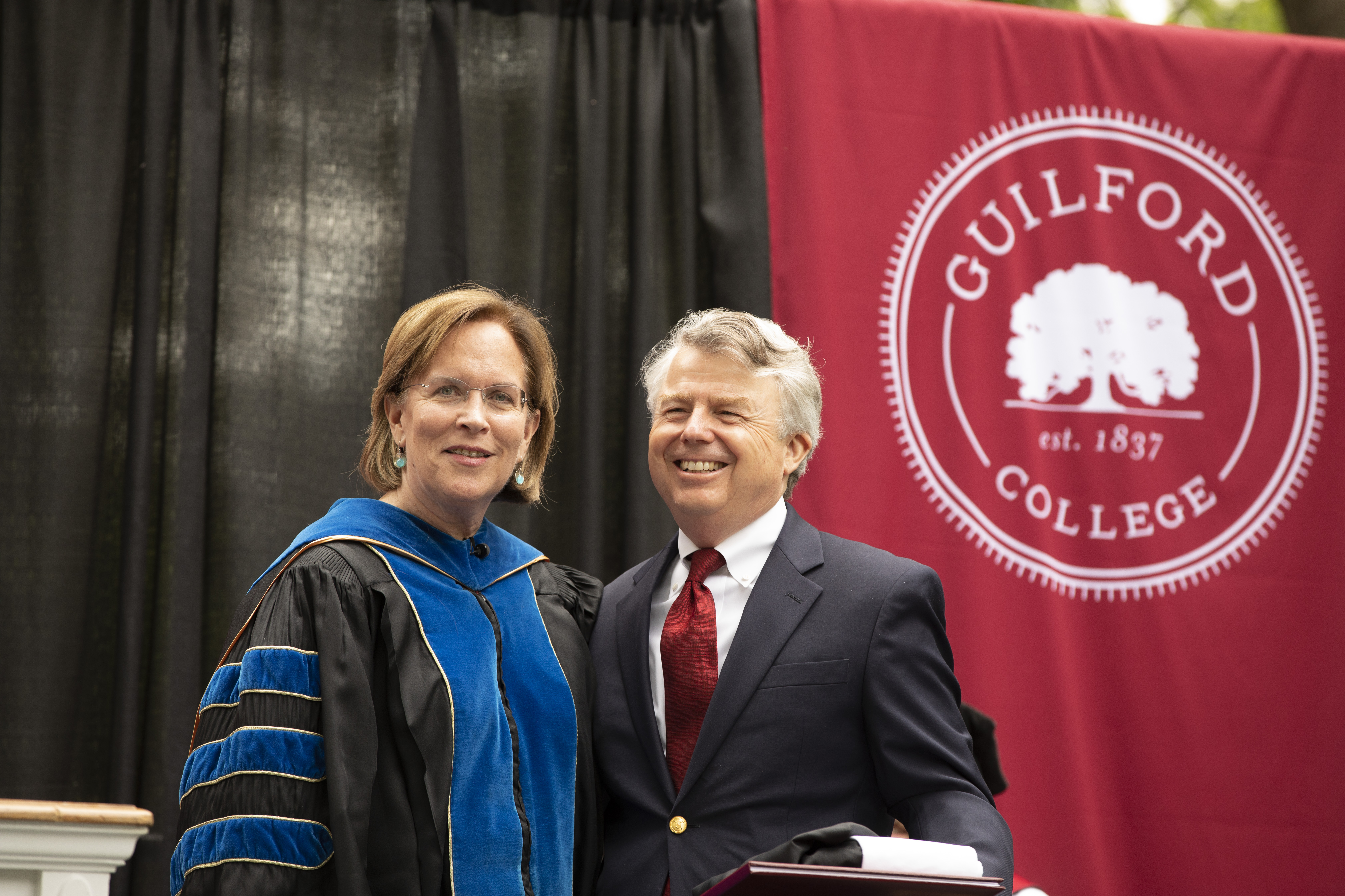 President Jane K. Fernandes (left) and Commencement speaker Dennis Quaintance of Quaintance-Weaver Restaurants and Hotels