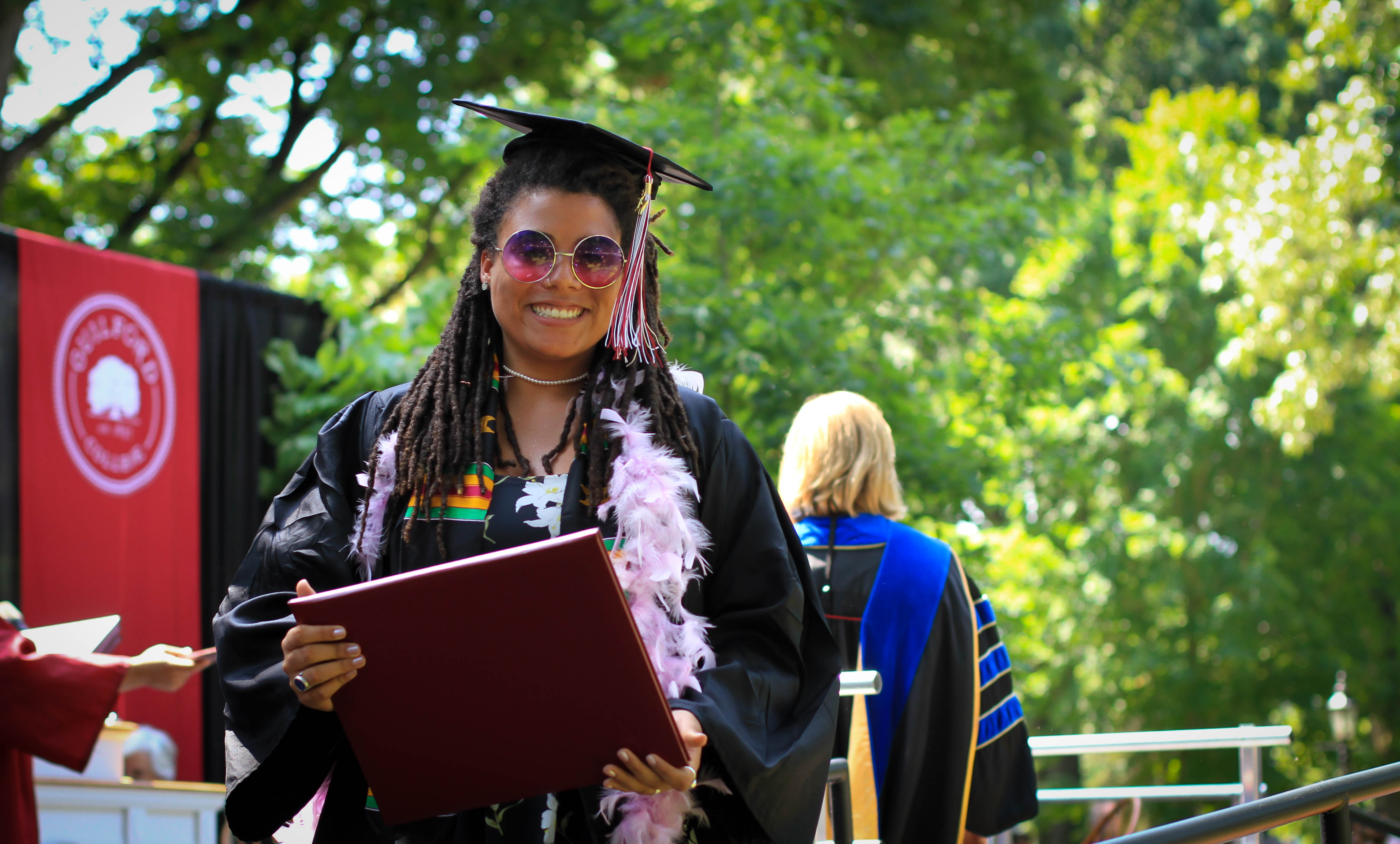 Grads are all smiles as they accept their diplomas.