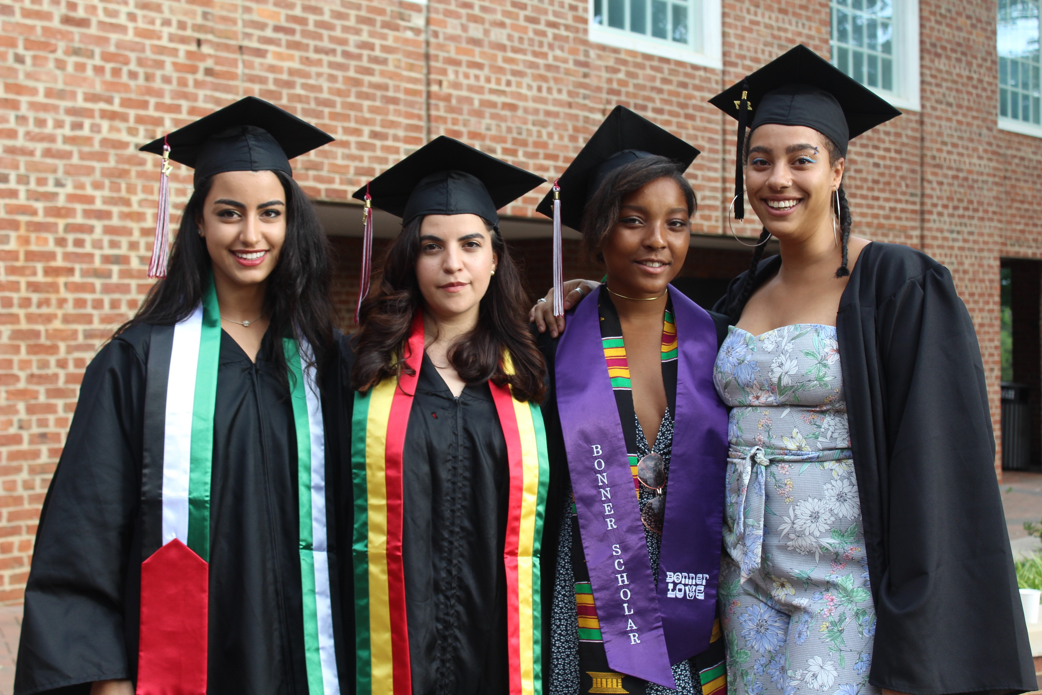 Grads snag an opportunity to take a photo together before Commencement.
