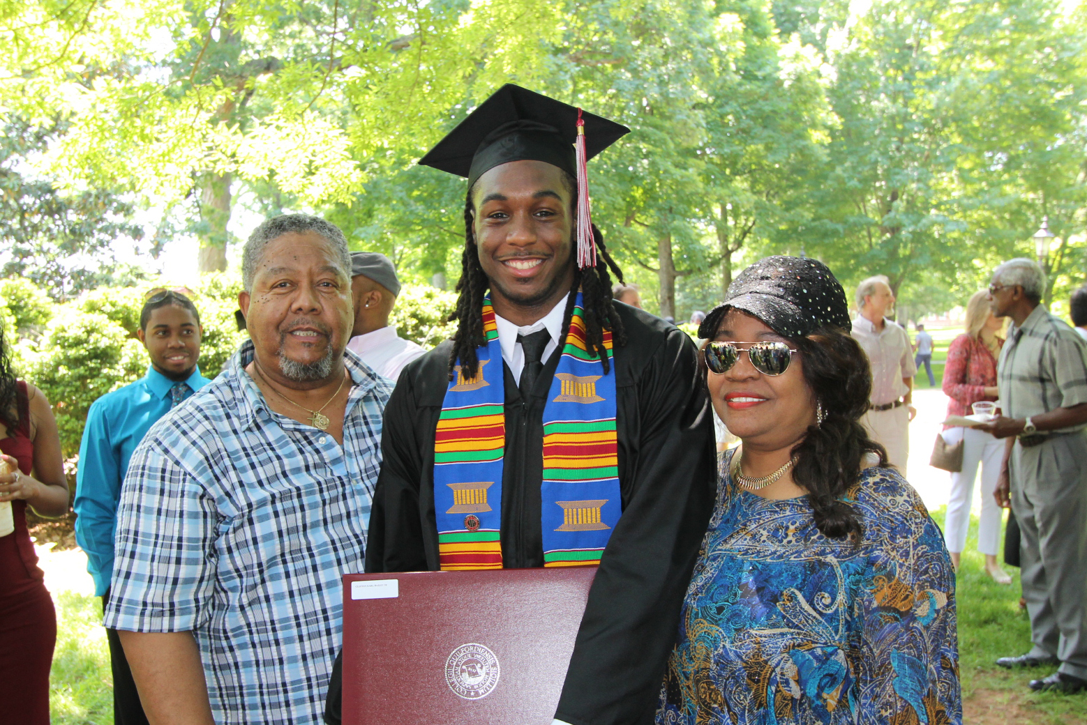 Proud parents with their graduate.