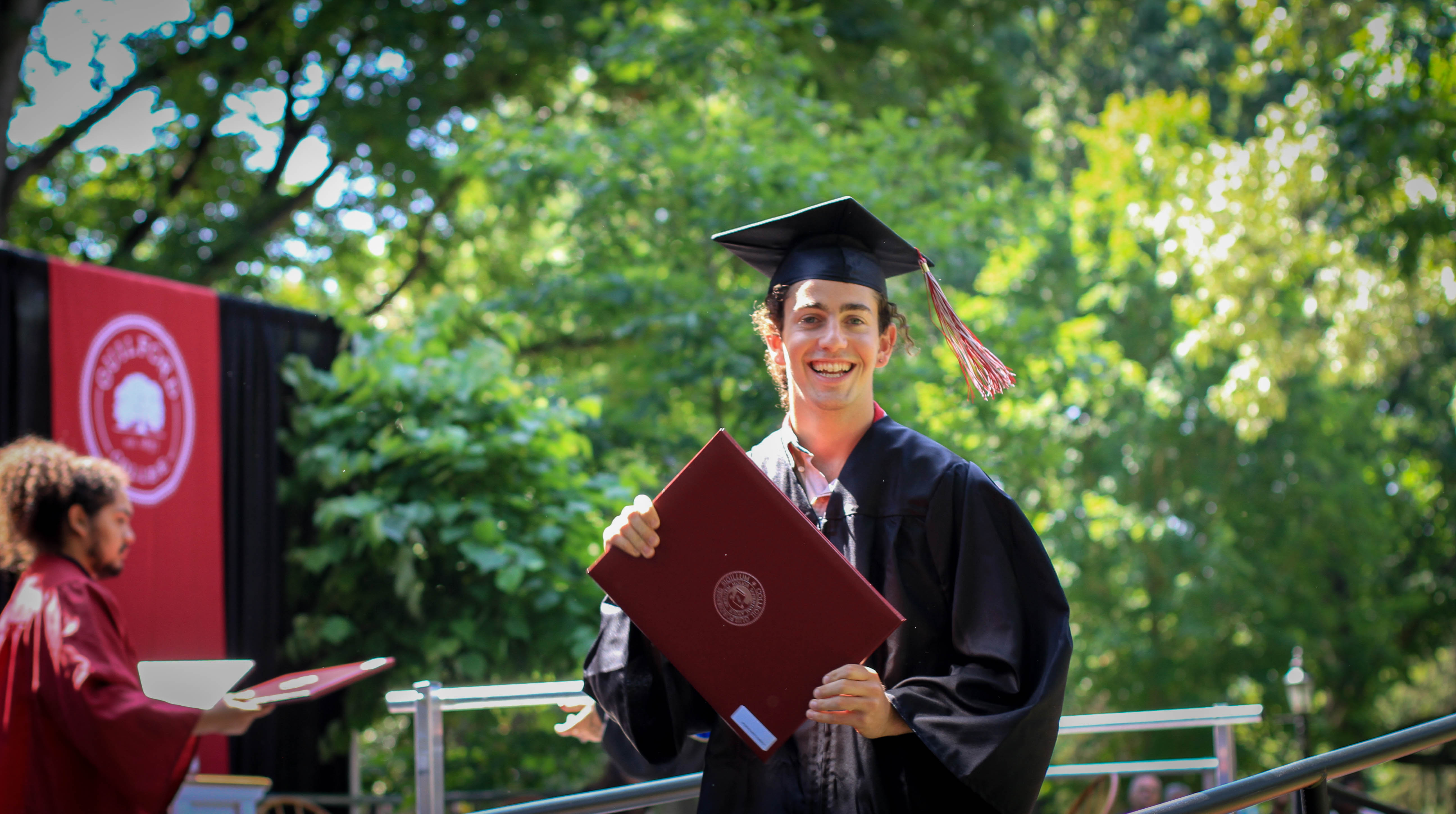 Patrick Nachlas poses with his diploma.