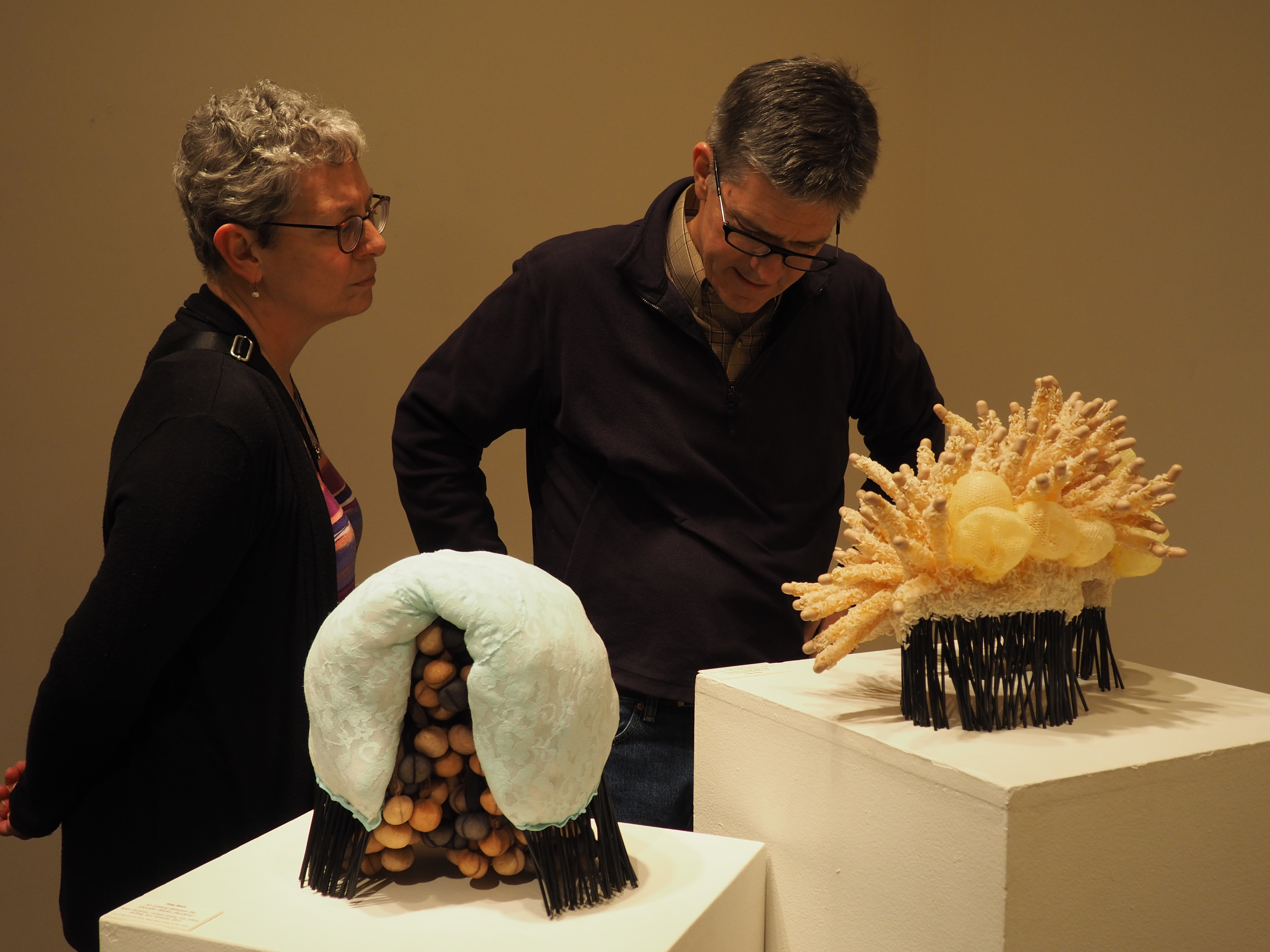 Attendees of the faculty art exhibition view Iceberg Between the Shoulder Blades by Meg Stein