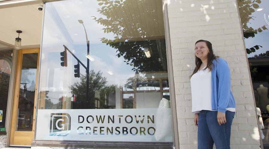Student Elizabeth Marshall '18 poses for a portrait outside the Downtown Greensboro offices.