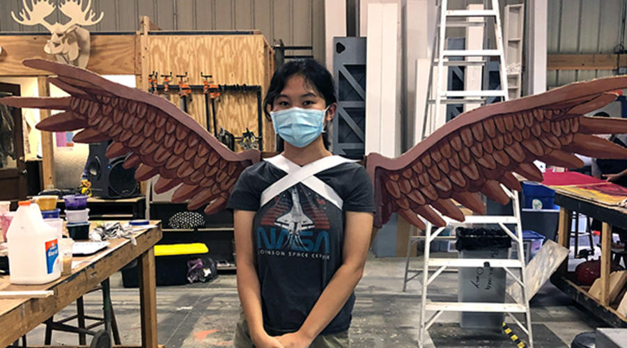 Student wearing painted wings.