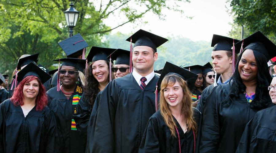 Students pose for a group photo after Commencement.