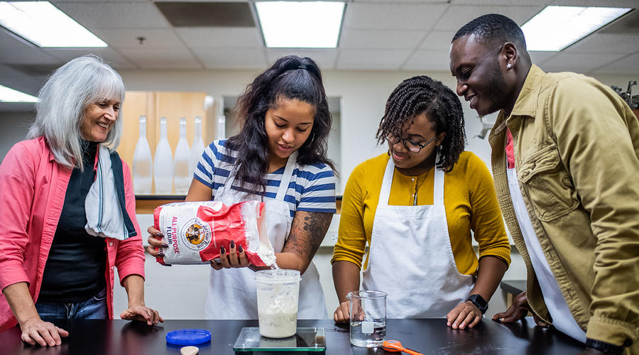 Students measure flour as they learn to bake during a Sustainable Food Systems course.