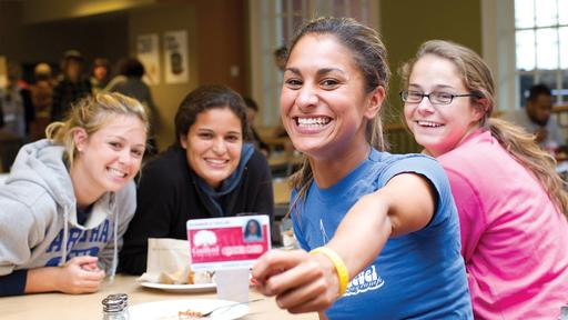 Students with their Quaker Card in the Dining Hall.