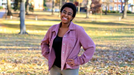 Student Mara Stewart stands on Guilford College's campus