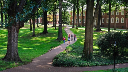 Guilford College students walk across the Quad.