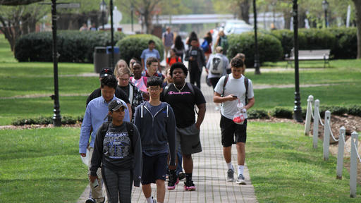Guilford College students walk to class on the Quad.