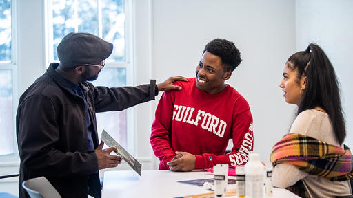 Guilford College students talk with Art Professor Antoine Williams.