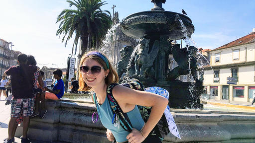 Amber Dumont poses for a photo in front of a fountain in Spain.