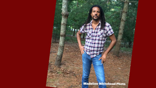 Portrait of Colson Whitehead standing outside.